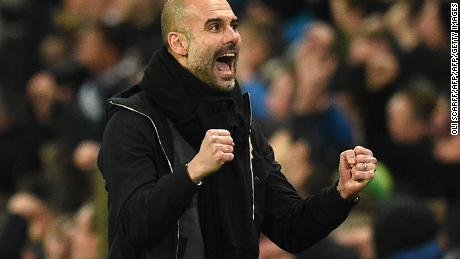 Manchester City's Spanish manager Pep Guardiola celebrates their first goal during the English Premier League football match between Manchester City and Newcastle United.