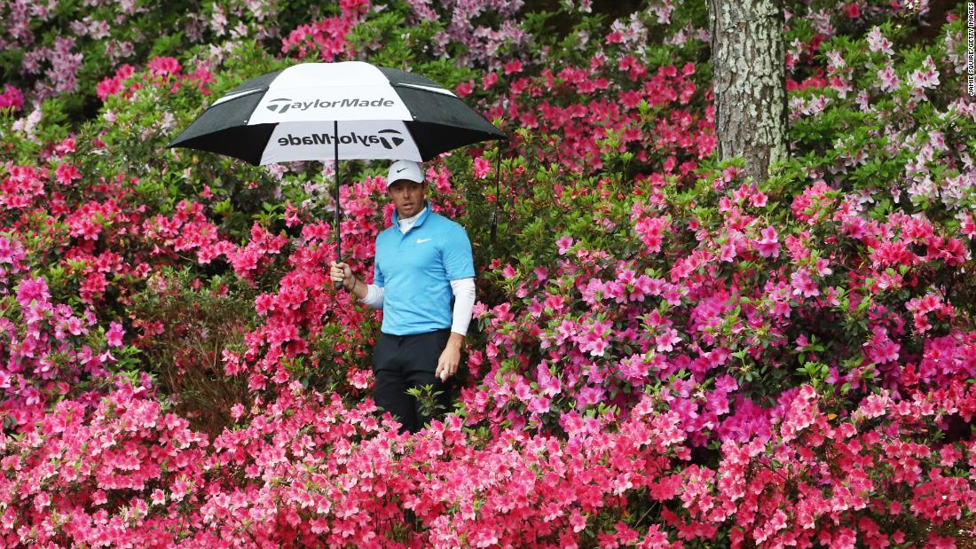 Rory McIlroy looks for his ball in the azalea bushes at the 13th hole during the third round of the 2018 Masters Tournament at Augusta National Golf Club on Saturday.