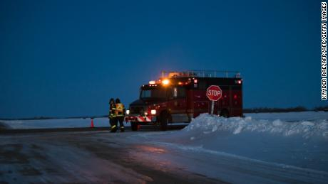 "An emergency vehicle is seen near the crash site on April 6, 2018 after a bus carrying a junior ice hockey team collided with a semi-trailer truck near Tisdale, Saskatchewan province, killing 14 people. Hockey-mad Canada was in mourning on Saturday after a bus carrying a junior ice hockey team collided with a semi-trailer truck in Saskatchewan province, killing 14 people.In a country where love of the sport is almost a religion, the crash sparked an outpouring of grief among players and fans on social media, while national political leaders expressed their sympathies.""We can now confirm 14 people have died as a result of this collision,"" the Royal Canadian Mounted Police said in a statement, which did not say how many of the victims were players or coaches of the Humboldt Broncos team.  / AFP PHOTO / Kymber RAEKYMBER RAE/AFP/Getty Images"