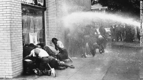 Black protesters came under attack by dogs and water cannons in 1963. Activists say there's a link between those protests and Birmingham's efforts to raise the minimum wage.