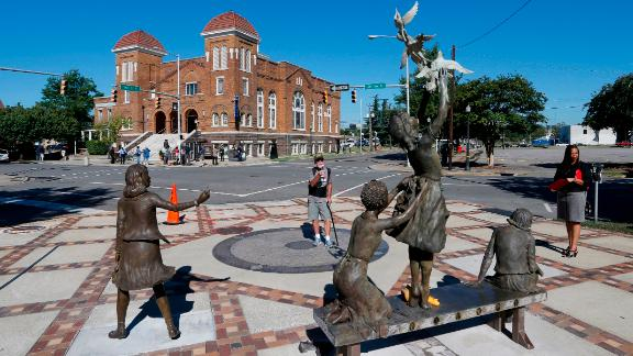 A statue honoring the four girls killed in the 1963 bombing of Birmingham's 16th Street Baptist Church graces the corner of Kelly Ingram Park.
