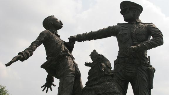 Birmingham's fight over the minimum wage, advocates say, echoes the city's epic civil rights campaign, memorialized in statues like this one.