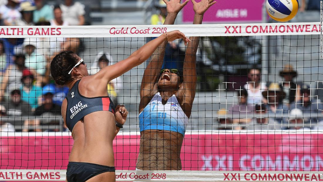 Laite Nima of Fiji tries to block Jessica Grimson of England.