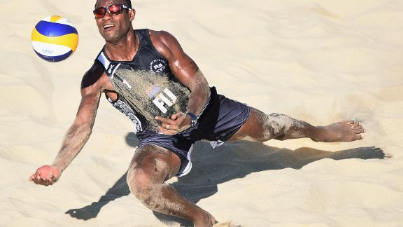 Inia Korowale of Fiji dives to save the point during the beach volleyball men