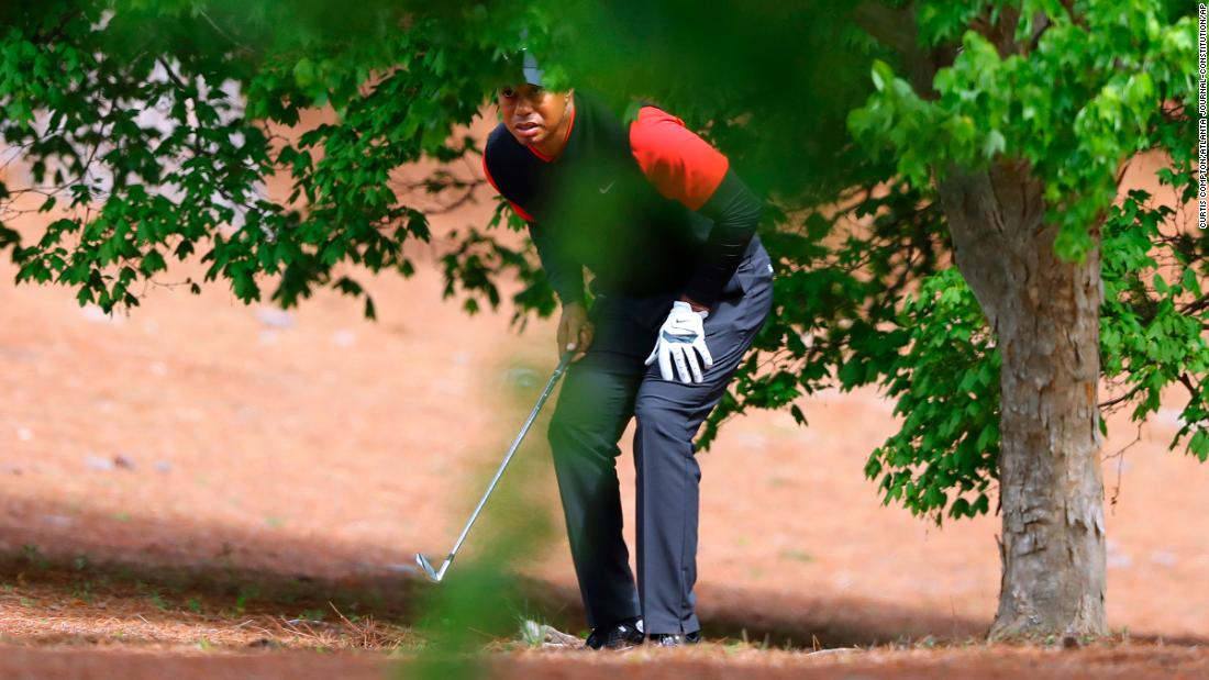 Tiger Woods prepares to hit out of the woods off the second fairway during his final round in the Masters on Sunday.