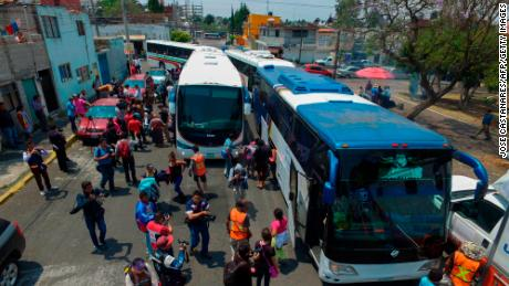 "Central American migrants taking part in the ""Migrant Via Crucis"" caravan towards the United States, arrive in Puebla, Puebla State, Mexico, on April 6, 2018 where they will attend a legal clinic with NGOs on human rights."