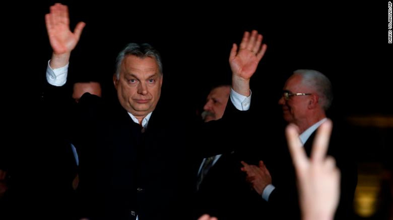 Orban greets supporters in Budapest on Sunday.