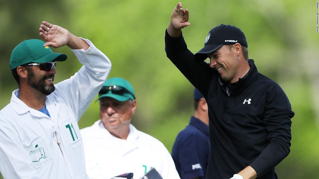 Jordan Spieth reacts on the 12th tee with caddie Michael Greller.