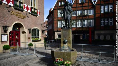 MUENSTER, GERMANY - APRIL 08: Flowers lay in front of the statue at the Kiepenkerl pub by the site of an attack with a van the day before that left three people dead and dozens injured on April 8, 2018 in Muenster, Germany. The driver, reportedly a German with psychiatric problems, drove the van with high speed into a crowd of people sitting outside a pub, killing two before he committed suicide with a gun. (Photo by Alexander Koerner/Getty Images)