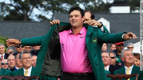 AUGUSTA, GA - APRIL 08:  Patrick Reed of the United States is awarded the Green Jacket by Sergio Garcia of Spain during the Green Jacket Ceremony after winning the 2018 Masters Tournament at Augusta National Golf Club on April 8, 2018 in Augusta, Georgia.  (Photo by David Cannon/Getty Images)