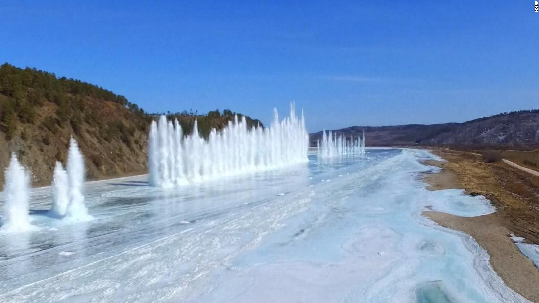 Frozen river blown up in China