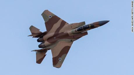 An Israeli F-15 fighter jet performs in an air show during the graduation ceremony of Israeli air force pilots at the Hatzerim base in the Negev desert, near the southern Israeli city of Beer Sheva, on December 29, 2016. / AFP / JACK GUEZ        (Photo credit should read JACK GUEZ/AFP/Getty Images)