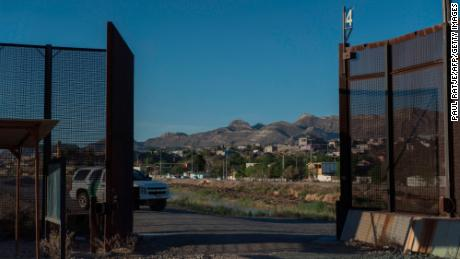 A Customs and Border Protection vehicle is pictured at an opening on the US-Mexico border fence near downtown El Paso, Texas, Sunday,  April 8, 2018. Openings like this are used for entry and exit of Border Patrol vehicles in the highly populated border metroplex.  The US states of Texas and Arizona announced plans to send National Guard troops to the southern border with Mexico after President Donald Trump ordered a thousands-strong deployment to combat drug trafficking and illegal immigration. / AFP PHOTO / Paul Ratje        (Photo credit should read PAUL RATJE/AFP/Getty Images)