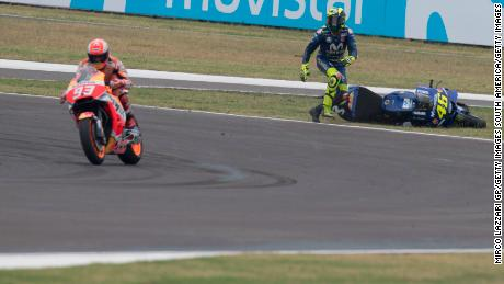 Valentino Rossi reacts furiously as Marc Marquez drives off following on-track collision.