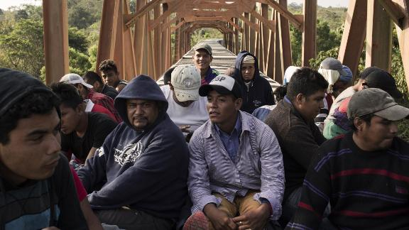 Central American migrants ride a freight train in Matias Romero on Sunday, April 1.