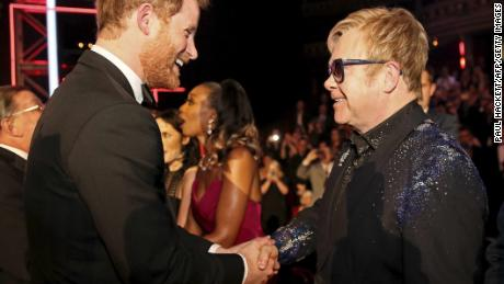 Britain's Prince Harry (L) greets British musician Elton John (R) at the Royal Variety Performance at the Royal Albert Hall in London on November 13, 2015. AFP PHOTO / POOL / PAUL HACKETT        (Photo credit should read PAUL HACKETT/AFP/Getty Images)