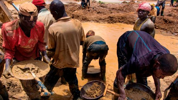 Gold miners working at a site in Kibi, eastern Ghana.