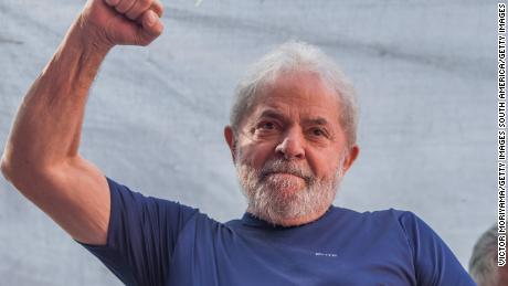 Former President Luiz Inacio Lula da Silva gestures to supporters at the headquarters of the Metalworkers' Union in April before his surrender to federal police.