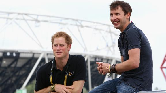 Prince Harry chats with singer James Blunt as he rehearses for the Invictus Games closing ceremony in London in 2014.