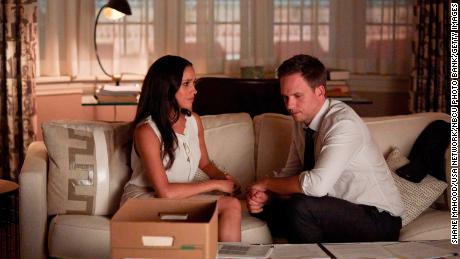 "Markle as Rachel Zane and Patrick J. Adams as Michael Ross in an episode of ""Suits."""