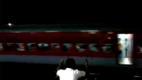 The runaway passenger train speeds through stations in eastern India, Saturday.