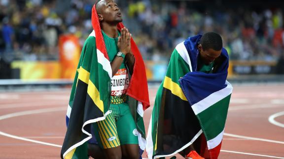 Akani Simbine and Henricho Bruintjies celebrate a one-two finish for South Africa in the 100m final.