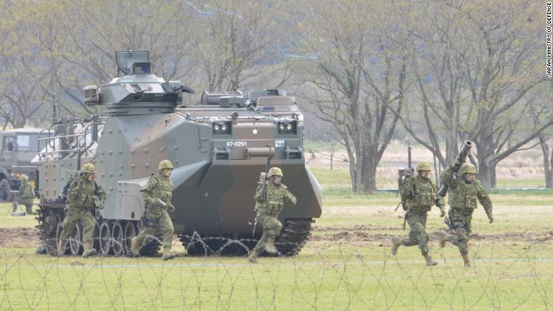 Japan's new amphibious rapid deployment brigade training on Saturday, April 7.