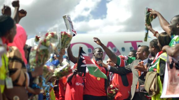 Andrew Amonde and the Kenya Sevens team get a warm reception at the Jomo Kenyatta Airport when they return home with the Singapore Sevens trophy.
