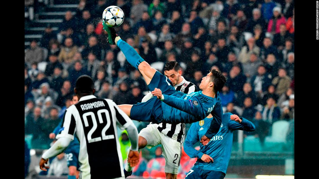 "Real Madrid star Cristiano Ronaldo connects on <a href=""http://bleacherreport.com/articles/2768286-cristiano-ronaldo-thanks-juventus-fans-for-applause-after-overhead-kick-goal"" target=""_blank"">a spectacular bicycle kick,</a> scoring a goal in the quarterfinals of the Champions League on Tuesday, April 3. Ronaldo scored twice in the 3-0 victory at Juventus. He said the bicycle kick, which earned applause from opposing fans, might be the best goal of his career."