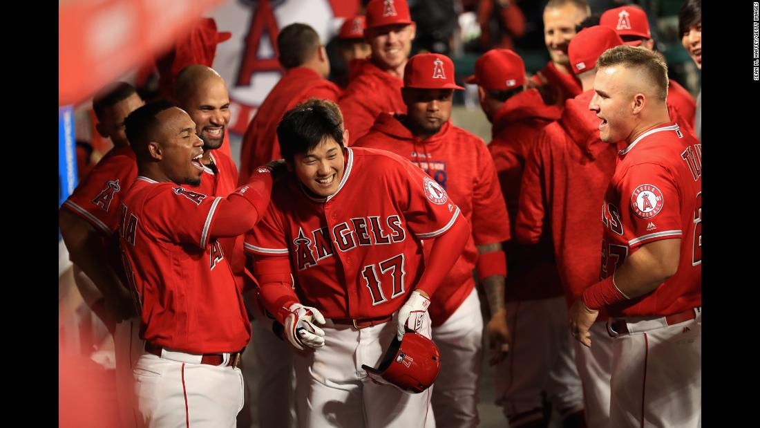 "Shohei Ohtani is congratulated by his Los Angeles Angels teammates after hitting his first Major League home run on Tuesday, April 3. In his first 10 games, <a href=""http://bleacherreport.com/articles/2768683-shohei-ohtani-proving-two-way-mlb-stardom-is-far-from-a-myth"" target=""_blank"">the Japanese phenom</a> has hit three home runs -- and won two games as a pitcher."