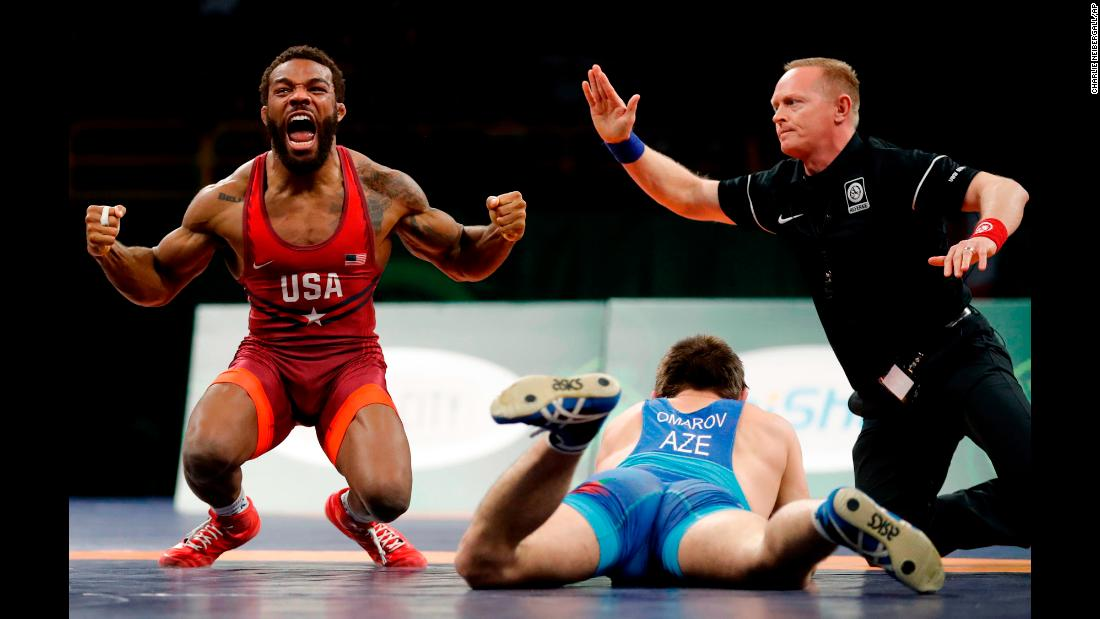 American wrestler Jordan Burroughs celebrates after pinning Azerbaijan's Gasjimurad Omarov at the Freestyle Wrestling World Cup on Sunday, April 8. The American team won the tournament, which was held in Iowa City, Iowa.
