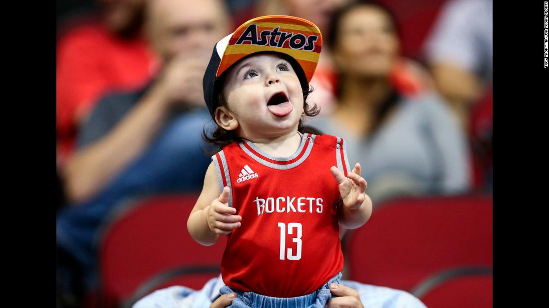A child watches warmups before an NBA game in Houston on Thursday, April 5.