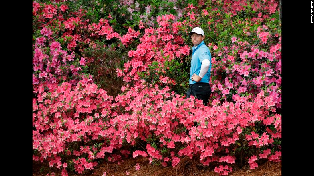 Rory McIlroy prepares to hit a shot out of some azaleas during the third round of the Masters on Saturday, April 7.