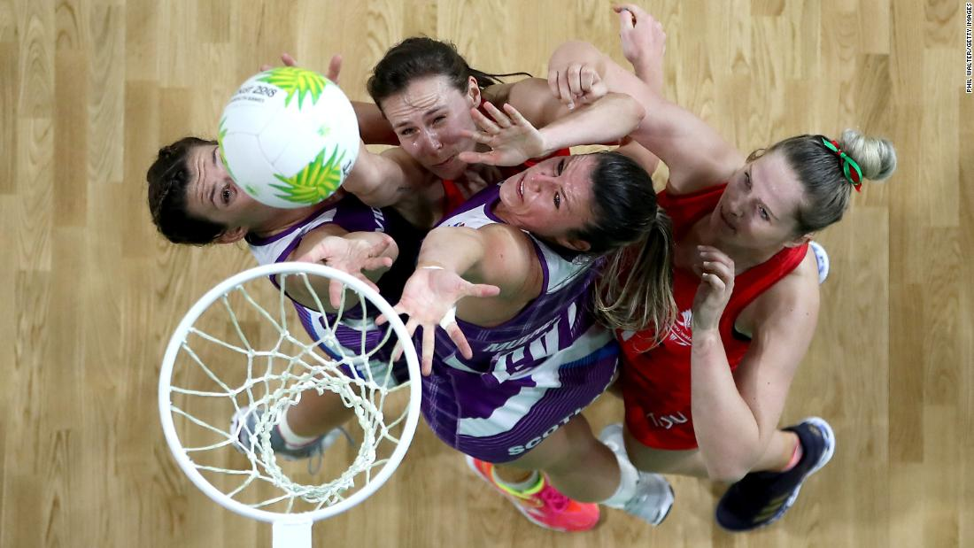 Netball players from Wales and Scotland compete for the ball during a match at the Commonwealth Games on Saturday, April 7.
