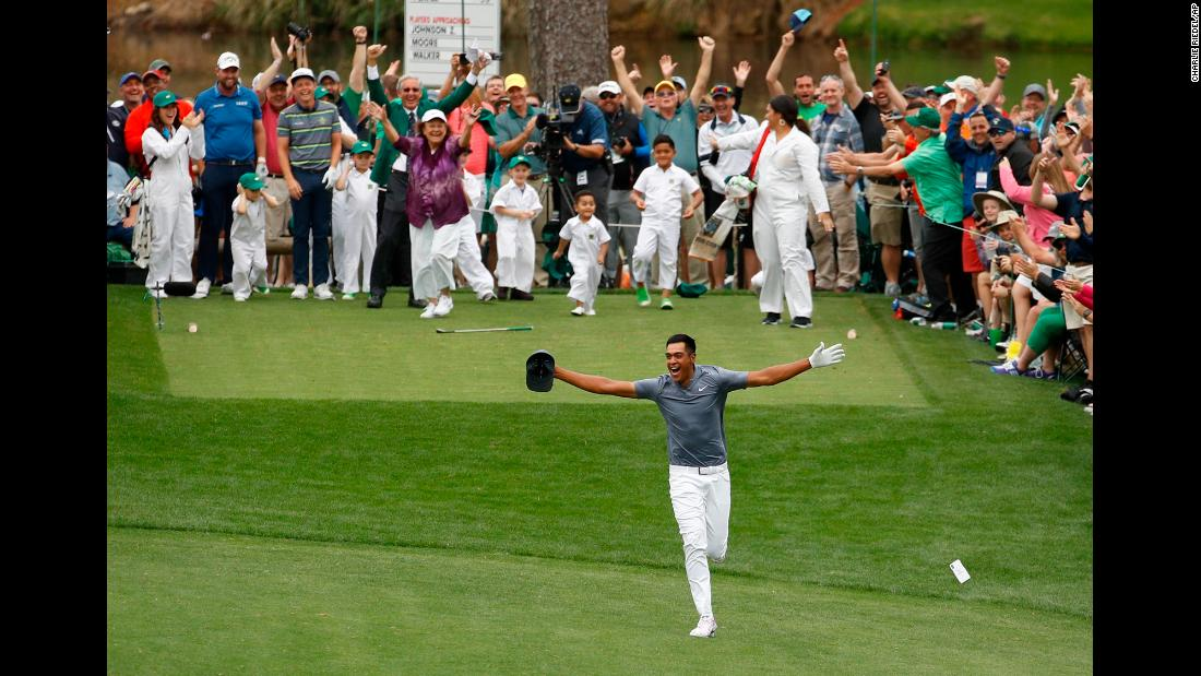 "Tony Finau celebrates after hitting a hole-in-one during the Masters' par-3 contest on Wednesday, April 4. <a href=""https://www.cnn.com/2018/04/05/golf/tony-finau-ankle-masters-par-three-jack-nicklaus-spt/index.html"" target=""_blank"">He dislocated his ankle during the celebration,</a> popped it back in himself, and went on to play in the tournament the next day."