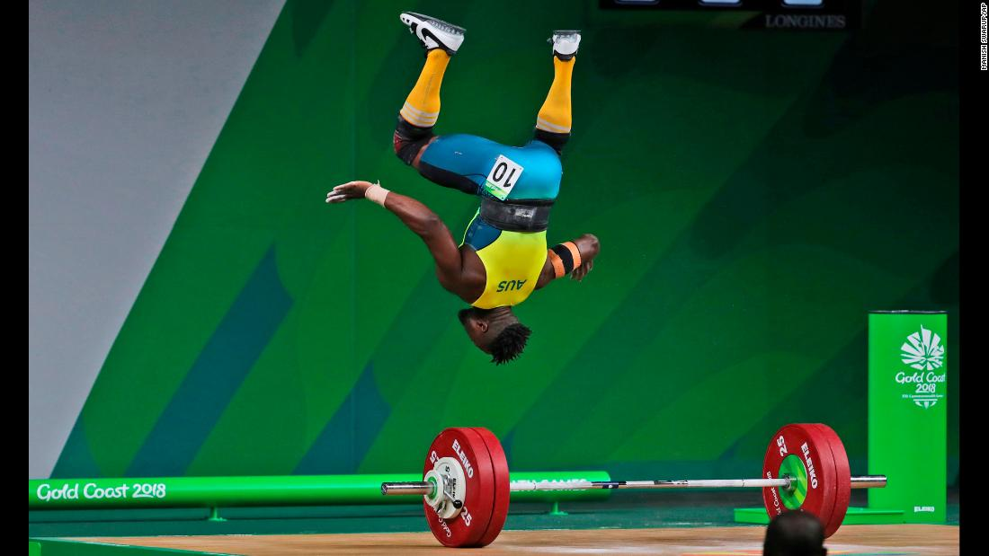 Australian weightlifter Francois Etoundi does a celebratory flip after completing a lift at the Commonwealth Games on Saturday, April 7. He finished with the bronze in his weight class.