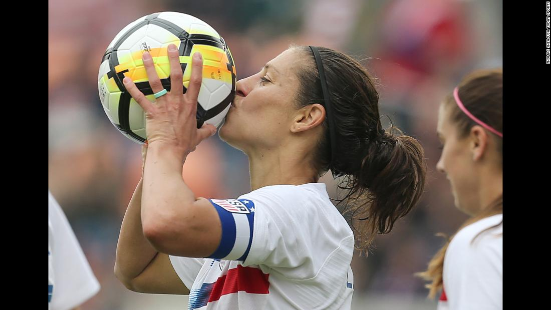 American soccer player Carli Lloyd kisses the ball after scoring her 100th international goal on Sunday, April 8. The United States defeated Mexico 6-2 in Houston.
