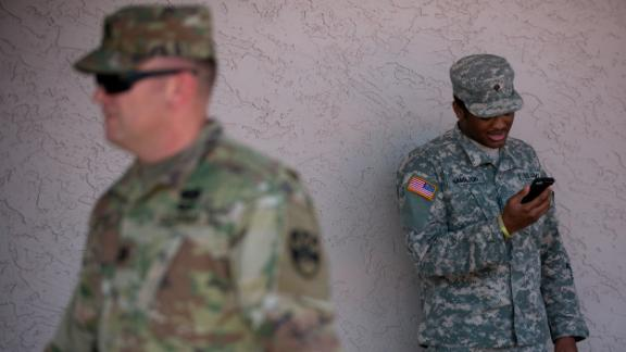 A member of the Arizona National Guard talks on the phone on April 9, 2018 at the Papago Park Military Reservation in Phoenix.