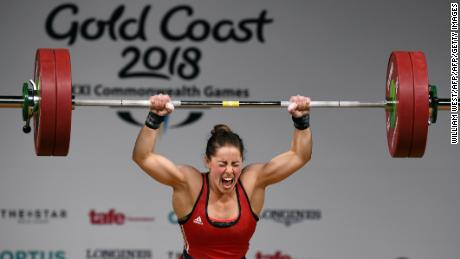 Maude Charron of Canada celebrates winning the gold medal in the women's 63kg weightlifting event at the 2018 Gold Coast Commonwealth Games at the Carrara Sports Arena on the Gold Coast on April 7, 2018.  / AFP PHOTO / WILLIAM WEST        (Photo credit should read WILLIAM WEST/AFP/Getty Images)