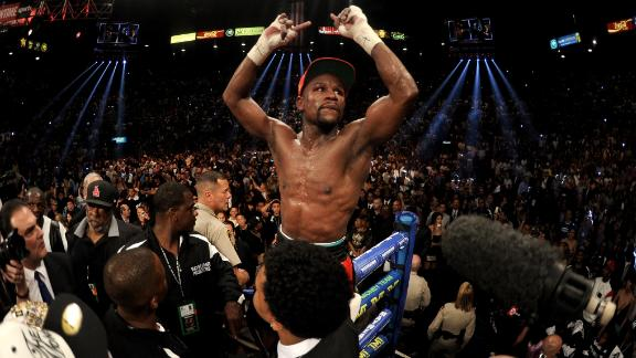 LAS VEGAS, NV - MAY 03:  Floyd Mayweather Jr. celebrates after defeating Marcos Maidana by majority decision in their WBC/WBA welterweight unification fight at the MGM Grand Garden Arena on May 3, 2014 in Las Vegas, Nevada.  (Photo by Harry How/Getty Images)