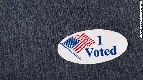 "Royalty-free stock photo ID: 415632082  Closeup of an American ""I voted"" sticker placed on a navy shirt."