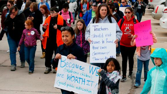 Teachers and supports march around the state Capitol on the fourth day of protests over school funding, in Oklahoma City, Thursday, April 5, 2018. (AP Photo/Sue Ogrocki)
