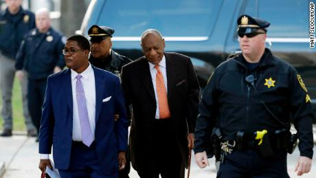 Bill Cosby, center, arrives at the courthouse on April 10.