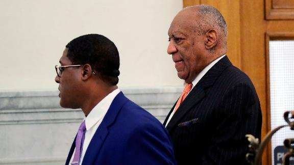 Actor and comedian Bill Cosby, right, arrives for his sexual assault retrial at the Montgomery County Courthouse in Norristown, Pa., on Tuesday, April 10, 2018. (David Maialetti/The Philadelphia Inquirer via AP, Pool)