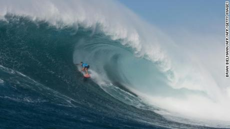 "Hawaiian surfer Billy Kemper surfs a big wave at Jaws, off the coast of the Maui Island in Hawai to win the Peahi Challenge 2016, on November 11, 2016. Kemper won the challenge for the second consecutive year.  Also known as ""Jaws,"" Pe'ahi is on the northern coastline of Maui and can produce waves that are upwards of 60 feet (18 meters).  / AFP / Brian BIELMANN / RESTRICTED TO EDITORIAL USE        (Photo credit should read BRIAN BIELMANN/AFP/Getty Images)"