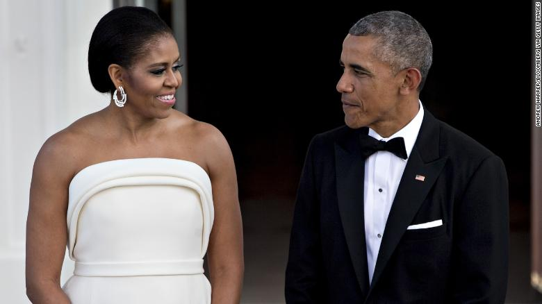U.S. President Barack Obama, right, and U.S. First Lady Michelle Obama talk as they wait during an arrival for Singapore Prime Minister Lee Hsien Loong, not pictured, to the State Dinner on the North Portico of the White House in Washington, D.C., U.S., on Tuesday, Aug. 2, 2016. The occasion marks first official visit by a Singapore prime minister since 1985. Photographer: Andrew Harrer/Bloomberg via Getty Images