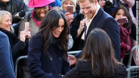 Harry and Meghan attend the Terrence Higgins Trust World AIDS Day charity fair in Nottingham, England, on December 1.
