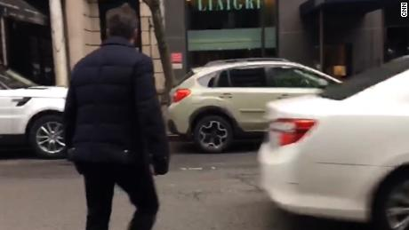 CNN has cell phone video of President Donald Trump's lawyer Michael Cohen exiting a side door connected to the Loews Regency Hotel in New York City Tuesday morning shortly after 9am. He does not speak or stop. He exited a side door of the hotel on 61st between Park and Madison which could be seen this morning being used to load and unload food and beverage items.