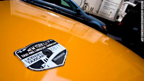 UNITED STATES - MAY 29:  A New York City Taxi and Limousine Commission medallion sits on the hood of a taxi in New York, Tuesday, May 29, 2007. New York City taxi medallions, the license to operate a cab that passengers hail on the street, sold for a record $600,000 each, the lender in the transaction said.  (Photo by Jin Lee/Bloomberg via Getty Images)