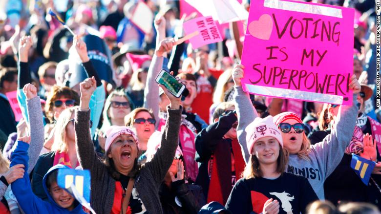 "LAS VEGAS, NV - JANUARY 21:  Attendees cheer a speaker during the Women's March ""Power to the Polls"" voter registration tour launch at Sam Boyd Stadium on January 21, 2018, in Las Vegas, Nevada. Demonstrators across the nation gathered over the weekend, one year after the historic Women's March on Washington, D.C., to protest President Donald Trump's administration and to raise awareness for women's issues.  (Photo by Sam Morris/Getty Images)"
